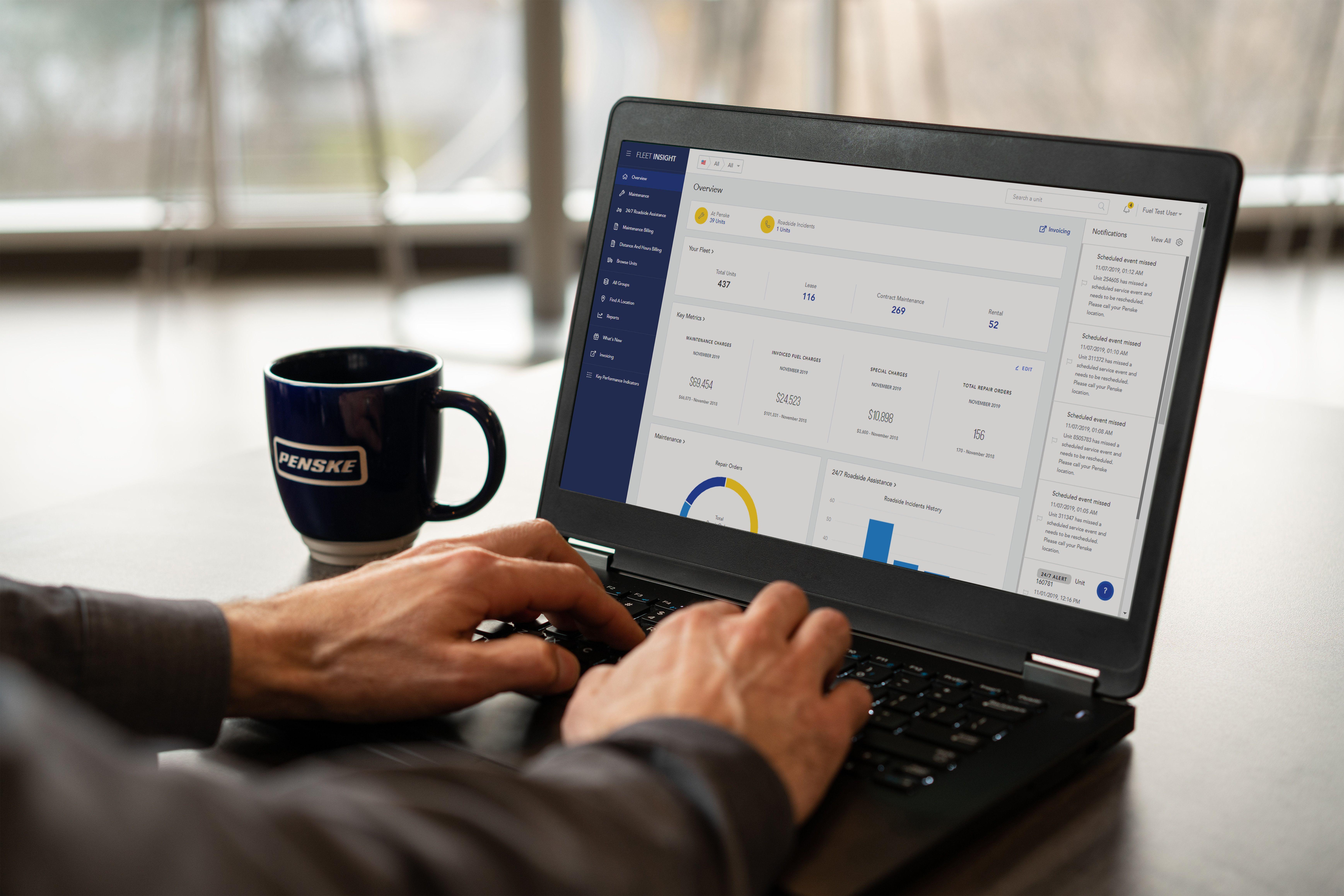 Customer using Fleet Insight on laptop