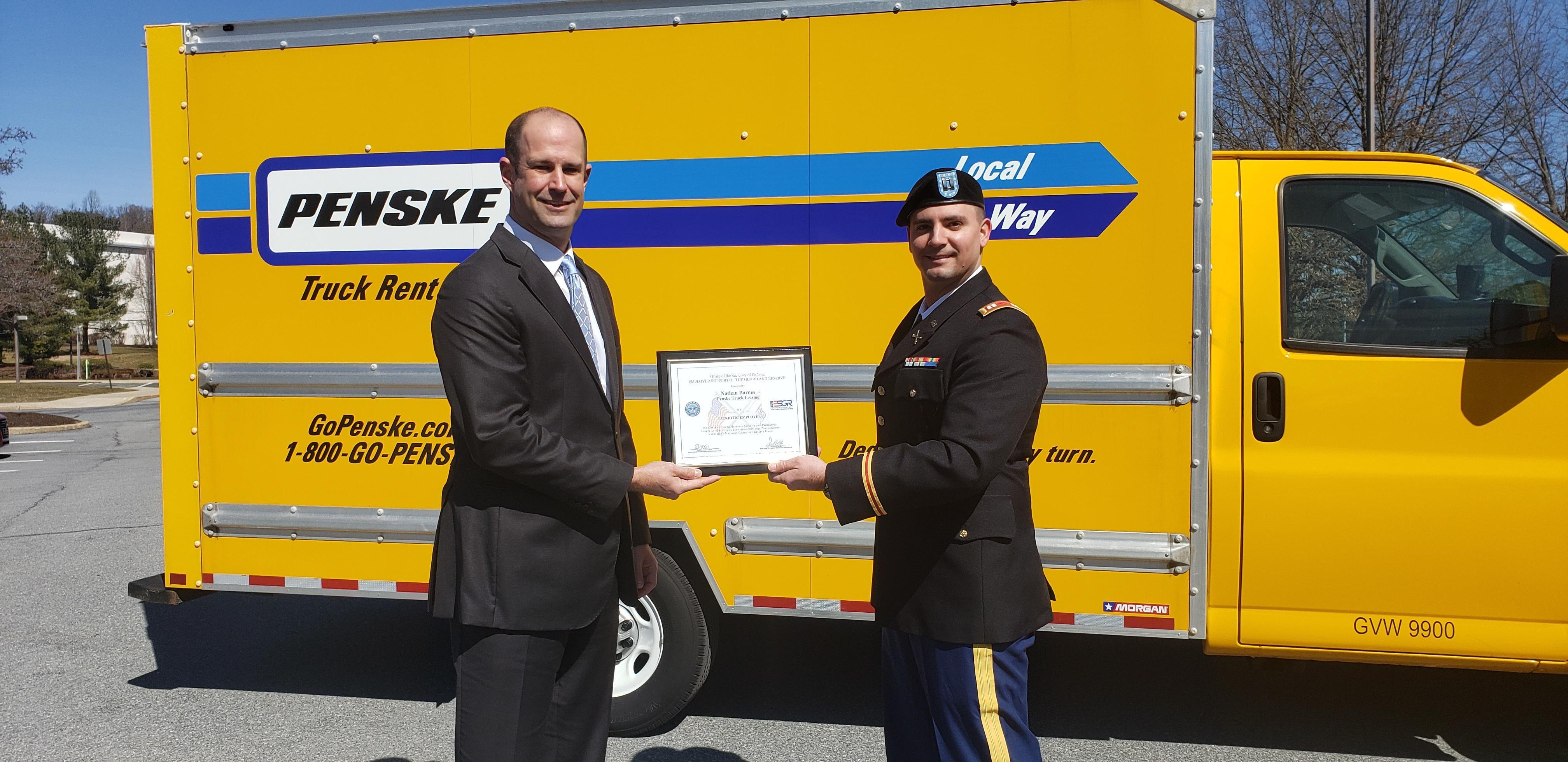 patriot award given in front of penske truck